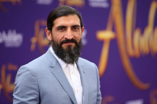 """LOS ANGELES, CA - MAY 21: Numan Acar attends the World Premiere of Disney's """"Aladdin"""" at the El Capitan Theater in Hollywood CA on May 21, 2019, in the culmination of the film's Magic Carpet World Tour with stops in Paris, London, Berlin, Tokyo, Mexico City and Amman, Jordan. (Photo by Jesse Grant/Getty Images for Disney) *** Local Caption *** Numan Acar"""