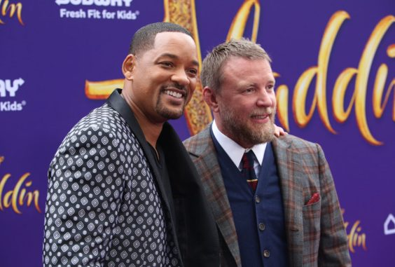 """LOS ANGELES, CA - MAY 21: Will Smith (L) and Director Guy Ritchie attend the World Premiere of Disney's """"Aladdin"""" at the El Capitan Theater in Hollywood CA on May 21, 2019, in the culmination of the film's Magic Carpet World Tour with stops in Paris, London, Berlin, Tokyo, Mexico City and Amman, Jordan. (Photo by Jesse Grant/Getty Images for Disney) *** Local Caption *** Will Smith; Guy Ritchie"""