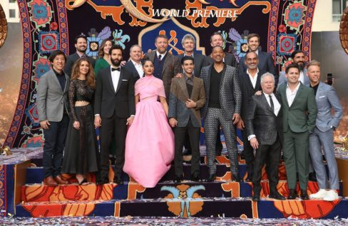 """LOS ANGELES, CA - MAY 21: (L-R front) Producer Dan Lin, actors Nasim Pedrad, Marwan Kenzari, Naomi Scott, Mena Massoud, Will Smith, Navid Negahban, Composer Alan Menken and co-lyricists Benj Pasek and Justin Paul. (L-R back) SVP, Production, The Walt Disney Studios, Louie Provost, Walt Disney Studios President, Alan Bergman, Director Guy Ritchie, Chairman, The Walt Disney Studios, Alan Horn, President of Walt Disney Studios Motion Picture Production, Sean Bailey, Producer Jonathan Eirich and actor Numan Acar attends the World Premiere of Disney's """"Aladdin"""" at the El Capitan Theater in Hollywood CA on May 21, 2019, in the culmination of the film's Magic Carpet World Tour with stops in Paris, London, Berlin, Tokyo, Mexico City and Amman, Jordan. (Photo by Jesse Grant/Getty Images for Disney) *** Local Caption *** Dan Lin; Nasim Pedrad; Marwan Kenzari; Naomi Scott; Mena Massoud; Will Smith; Navid Negahban; Alan Menken; Benj Pasek; Justin Paul; Louie Provost; Alan Bergman; Guy Ritchie; Alan Horn; Sean Bailey; Jonathan Eirich; Numan Acar"""