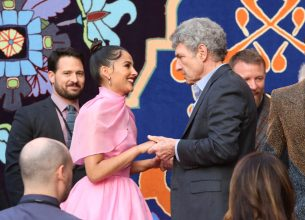 """LOS ANGELES, CA - MAY 21: Naomi Scott (L) and Chairman, The Walt Disney Studios, Alan Horn attend the World Premiere of Disney's """"Aladdin"""" at the El Capitan Theater in Hollywood CA on May 21, 2019, in the culmination of the film's Magic Carpet World Tour with stops in Paris, London, Berlin, Tokyo, Mexico City and Amman, Jordan. (Photo by Jesse Grant/Getty Images for Disney) *** Local Caption *** Naomi Scott; Alan Horn"""