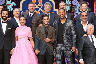 """LOS ANGELES, CA - MAY 21: (L-R front) Actors Marwan Kenzari, Naomi Scott, Mena Massoud, Will Smith, Navid Negahban and Composer Alan Menken . (L-R back) Walt Disney Studios President, Alan Bergman, Director Guy Ritchie, Chairman, The Walt Disney Studios, Alan Horn, President of Walt Disney Studios Motion Picture Production, Sean Bailey and producer Jonathan Eirich attend the World Premiere of Disney's """"Aladdin"""" at the El Capitan Theater in Hollywood CA on May 21, 2019, in the culmination of the film's Magic Carpet World Tour with stops in Paris, London, Berlin, Tokyo, Mexico City and Amman, Jordan. (Photo by Jesse Grant/Getty Images for Disney) *** Local Caption *** Marwan Kenzari; Naomi Scott; Mena Massoud; Will Smith; Navid Negahban; Alan Menken; Alan Bergman; Guy Ritchie; Alan Horn; Sean Bailey; Jonathan EirichJonathan Eirich"""
