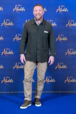 """Guy Ritchie attends the photo call to celebrate the release of Disney's """"Aladdin"""" on May 10th in London, UK"""