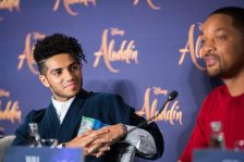"""(L-R) Mena Massoud and Will Smith attend the """"Aladdin"""" press conference on May 11, 2019 in Berlin, Germany. .© Disney/Folioscope/Hanna Boussouar"""