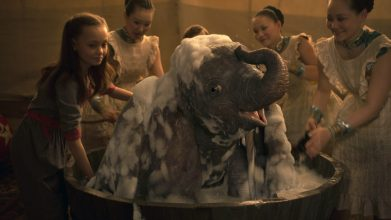 "BATHTIME -- In Disney's live-action reimagining of ""Dumbo,"" Milly Farrier—the daughter of a former circus star charged with caring for a newborn elephant—quickly embraces the newest member of their circus family. Featuring Nico Parker as Milly, ""Dumbo"" opens in U.S. theaters on March 29, 2019...© 2019 Disney Enterprises, Inc. All Rights Reserved."