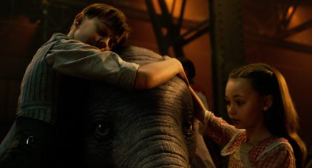 """TRUE LOVE -- When former circus star Holt Farrier (Colin Farrell) is charged with taking care of a newborn elephant whose oversized ears make him a laughingstock in an already struggling circus, he's surprised by just how quickly his children (Finley Hobbins and Nico Parker) fall for the peculiar pachyderm. Directed by Tim Burton and produced by Katterli Frauenfelder, Derek Frey, Ehren Kruger and Justin Springer, Disney's all-new, live-action reimagining of """"Dumbo"""" flies into theaters on March 29, 2019. © 2018 Disney Enterprises, Inc. All Rights Reserved."""