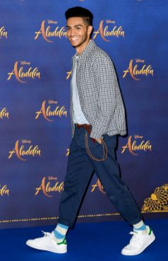 """LONDON, ENGLAND - MAY 10: Mena Massoud attends the photocall to celebrate release of Disney's """"Aladdin"""" at The Rosewood Hotel on May 10, 2019 in London, England. (Photo by Gareth Cattermole/Gareth Cattermole/Getty Images for Disney)"""