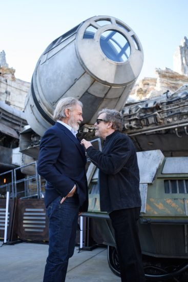 Star Wars Actors Tour Star Wars: Galaxy's Edge at Disneyland Park Ahead of Opening Actors Harrison Ford, and Mark Hamill pose in front of the Millennium Falcon at Star Wars: Galaxy's Edge at Disneyland Park in Anaheim, California, May 29, 2019. Star Wars: Galaxy's Edge opens May 31, 2019, at Disneyland Resort in California and Aug. 29, 2019, at Walt Disney World Resort in Florida.  (Richard Harbaugh/Disneyland Resort)