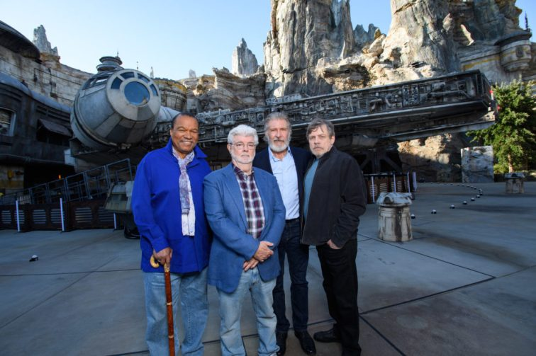 Star Wars Actors Tour Star Wars: Galaxy's Edge at Disneyland Park Ahead of Opening Actor Billy Dee Williams, Star Wars creator George Lucas, actors Harrison Ford and Mark Hamill pose in front of the Millennium Falcon at Star Wars: Galaxy's Edge at Disneyland Park in Anaheim, California, May 29, 2019. Star Wars: Galaxy's Edge opens May 31, 2019, at Disneyland Resort in California and Aug. 29, 2019, at Walt Disney World Resort in Florida.  (Richard Harbaugh/Disneyland Resort)