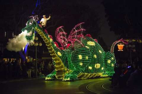 "Pete's Dragon dazzles in the night during the Main Street Electrical Parade at Disneyland Park. The nostalgic fan-favorite Main Street Electrical Parade will once again create magical summer memories for guests of all ages at Disneyland Park, with a limited-time encore engagement taking place nightly, from Aug. 2 – Sept. 30, 2019. The nighttime spectacle features half-million sparkling lights and ""electro-syntho-magnetic musical sounds."" Disneyland Resort is located in Anaheim, Calif. (Scott Brinegar/Disneyland)"