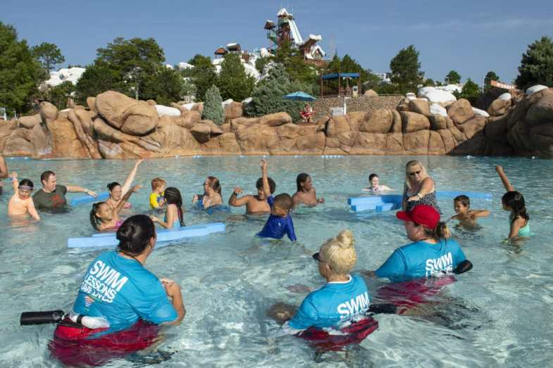 "Swim instructors team up with three-time Olympic gold medalist swimmer Rowdy Gaines to teach kids about water safety as part of the ""World's Largest Swimming Lesson"" event at Disney's Blizzard Beach. Nearly 200 people participated at Disney as part of the global event that took place in 28 countries around the world."
