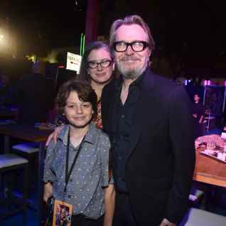 HOLLYWOOD, CA - JUNE 11: Gisele Schmidt, Gary Oldman and guest attend the world premiere of Disney and Pixar's TOY STORY 4 at the El Capitan Theatre in Hollywood, CA on Tuesday, June 11, 2019. (Photo by Alberto E. Rodriguez/Getty Images for Disney) *** Local Caption *** Gary Oldman; Gisele Schmidt