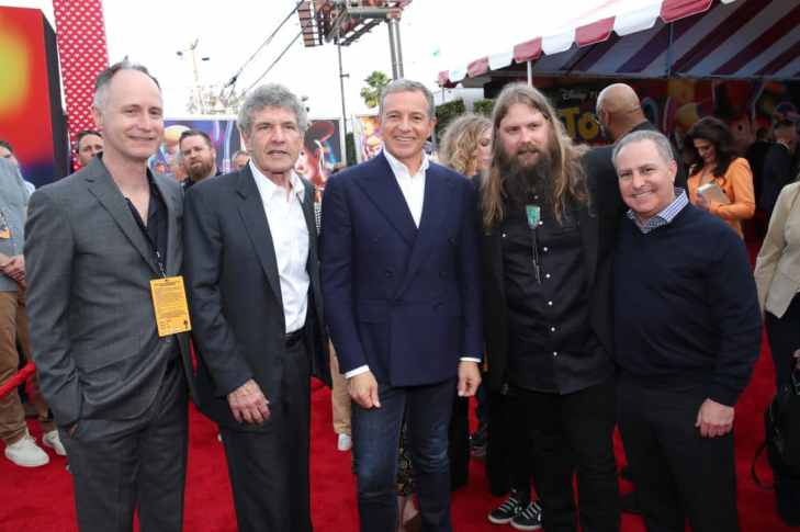 HOLLYWOOD, CA - JUNE 11: (L-R) Walt Disney Studios EVP of Music Tom MacDougall, Chairman, The Walt Disney Studios, Alan Horn, The Walt Disney Company Chairman and CEO Bob Iger, Singer Chris Stapleton and Walt Disney Studios President, Alan Bergman attend the world premiere of Disney and Pixar's TOY STORY 4 at the El Capitan Theatre in Hollywood, CA on Tuesday, June 11, 2019. (Photo by Rich Polk/Getty Images for Disney) *** Local Caption *** Alan Horn; Bob Iger; Chris Stapleton; Alan Bergman
