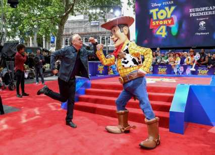 """LONDON, ENGLAND - JUNE 16: Tom Hanks and Woody attend the European premiere of Disney and Pixar's """"Toy Story 4"""" at the Odeon Luxe Leicester Square on June 16, 2019 in London, England. (Photo by Gareth Cattermole/Getty Images for Disney and Pixar)"""