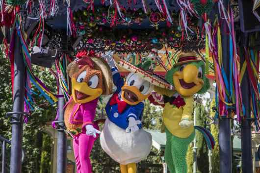 """The Disneyland Resort transforms into the Merriest Place on Earth for the holiday season, Nov. 8, 2019, through Jan. 6, 2020. Among the merriment at Disney California Adventure Park, The Three Caballeros host the popular """"Disney ¡Viva Navidad! Street Party"""" celebration, featuring folklórico and samba dancers, live musicians, and Mickey and Minnie in their fiesta best. (Joshua Sudock/Disneyland Resort)"""