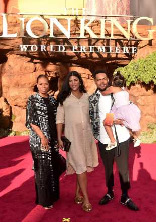 """HOLLYWOOD, CALIFORNIA - JULY 09: (L-R) Lisa Bennett, Kirsten Corley, Chance The Rapper, and Kensli Bennett attend the World Premiere of Disney's """"THE LION KING"""" at the Dolby Theatre on July 09, 2019 in Hollywood, California. (Photo by Alberto E. Rodriguez/Getty Images for Disney)"""
