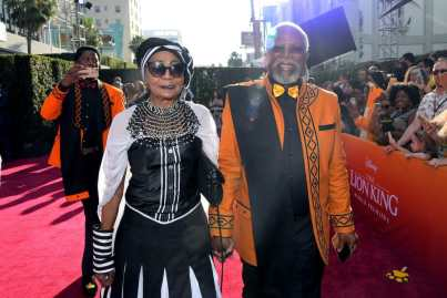 "HOLLYWOOD, CALIFORNIA - JULY 09: Mandi Kani (L) and John Kani attend the World Premiere of Disney's ""THE LION KING"" at the Dolby Theatre on July 09, 2019 in Hollywood, California. (Photo by Charley Gallay/Getty Images for Disney)"