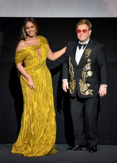 """LONDON, ENGLAND - JULY 14: Beyonce Knowles-Carter and Sir Elton John attend the European Premiere of Disney's """"The Lion King"""" at Odeon Luxe Leicester Square on July 14, 2019 in London, England. (Photo by Gareth Cattermole/Getty Images for Disney)"""