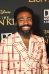 "HOLLYWOOD, CALIFORNIA - JULY 09: Donald Glover attends the World Premiere of Disney's ""THE LION KING"" at the Dolby Theatre on July 09, 2019 in Hollywood, California. (Photo by Jesse Grant/Getty Images for Disney)"