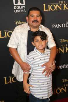 "HOLLYWOOD, CALIFORNIA - JULY 09: Guillermo Rodriguez (L) attends the World Premiere of Disney's ""THE LION KING"" at the Dolby Theatre on July 09, 2019 in Hollywood, California. (Photo by Jesse Grant/Getty Images for Disney)"