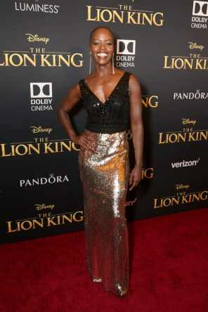 "HOLLYWOOD, CALIFORNIA - JULY 09: Florence Kasumba attends the World Premiere of Disney's ""THE LION KING"" at the Dolby Theatre on July 09, 2019 in Hollywood, California. (Photo by Jesse Grant/Getty Images for Disney)"