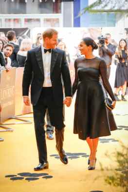 """Prince Harry, Duke of Sussex and Meghan, Duchess of Sussex attend the European Premiere of Disney's """"The Lion King"""" at the Odeon Leicester Square on 14th July 2019 in London, UK"""