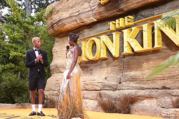 Pharrell Williams and Clara Amfo attends the European Premiere of DisneyÕs ÒThe Lion KingÓ at the Odeon Leicester Square on 14th July 2019 in London, UK