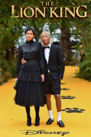 Helen Lasichanh and Pharrell Williams attend the European Premiere of DisneyÕs ÒThe Lion KingÓ at the Odeon Leicester Square on 14th July 2019 in London, UK