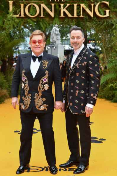 """Elton John and David Furnish attend the European Premiere of Disney's """"The Lion King"""" at the Odeon Leicester Square on 14th July 2019 in London, UK"""