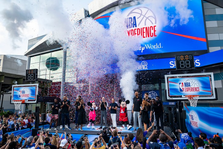 Disney Chairman and CEO Bob Iger and NBA Commissioner Adam Silver are joined by NBA and WNBA players and legends for the grand opening of NBA Experience at Disney Springs on Monday, Aug. 12, 2019, at Walt Disney World Resort in Lake Buena Vista, Fla. From left: Mike Conley (Utah Jazz), Aaron Gordon (Orlando Magic), Grant Hill (Naismith Hall of Famer), Udonis Haslem (Miami Heat), Swin Cash (WNBA legend), Minnie Mouse, NBA Commissioner Adam Silver, Disney Chairman and CEO Bob Iger, Mickey Mouse, Kareem Abdul-Jabbar (Naismith Hall of Famer), Rachel Nichols (ESPN host), Brook Lopez (Milwaukee Bucks), Victor Oladipo (Indiana Pacers), Dwyane Wade (NBA legend). The first-of-its-kind destination invites fans of all ages to enter the world of professional basketball in an immersive, interactive venue celebrating the NBA and WNBA. (Matt Stroshane, photographer)