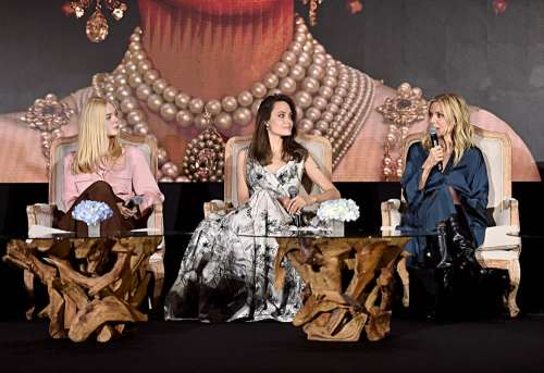"BEVERLY HILLS, CALIFORNIA - SEPTEMBER 30: (L-R) Actors Elle Fanning, Angelina Jolie and Michelle Pfeiffer participate in the global press conference for ""Disney's Maleficent: Mistress of Evil"" on September 30, 2019 in Beverly Hills, California. (Photo by Alberto E. Rodriguez/Getty Images for Disney)"