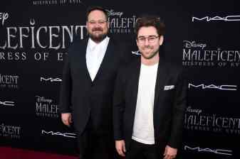 "HOLLYWOOD, CALIFORNIA - SEPTEMBER 30: (L-R) Co-screenwriters Noah Harpster and Micah Fitzerman-Blue attend the World Premiere of Disney's ""Maleficent: Mistress of Evil"" at the El Capitan Theatre on September 30, 2019 in Hollywood, California. (Photo by Alberto E. Rodriguez/Getty Images for Disney)"