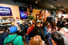 NEW YORK, NEW YORK - OCTOBER 04: Star Wars fans attend Triple Force Friday on October 04, 2019 during the midnight opening at Disney Store Times Square in New York City. (Photo by Noam Galai/Getty Images for Disney)