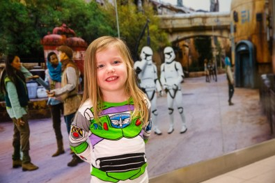 A young girl prepares to board a shuttle to the Main Terminal at Orlando International Airport, Nov. 16, 2019, in Orlando Fla. Disney installed artistic renderings on the terminal shuttle stations to bring the adventure of Star Wars: Galaxy's Edge at Disney's Hollywood Studios to airport travelers. (Steven Diaz, photographer)