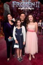 """HOLLYWOOD, CALIFORNIA - NOVEMBER 07: Songwriter Kristen Anderson-Lopez, Annie Lopez, songwriter Robert Lopez, and Katie Lopez attend the world premiere of Disney's """"Frozen 2"""" at Hollywood's Dolby Theatre on Thursday, November 7, 2019 in Hollywood, California. (Photo by Alberto E. Rodriguez/Getty Images for Disney)"""