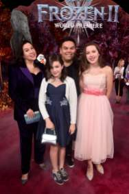 "HOLLYWOOD, CALIFORNIA - NOVEMBER 07: Songwriter Kristen Anderson-Lopez, Annie Lopez, songwriter Robert Lopez, and Katie Lopez attend the world premiere of Disney's ""Frozen 2"" at Hollywood's Dolby Theatre on Thursday, November 7, 2019 in Hollywood, California. (Photo by Alberto E. Rodriguez/Getty Images for Disney)"