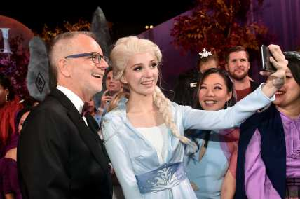 "HOLLYWOOD, CALIFORNIA - NOVEMBER 07: (L-R) Director Chris Buck and Elsa attend the world premiere of Disney's ""Frozen 2"" at Hollywood's Dolby Theatre on Thursday, November 7, 2019 in Hollywood, California. (Photo by Alberto E. Rodriguez/Getty Images for Disney)"