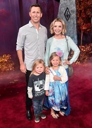"HOLLYWOOD, CALIFORNIA - NOVEMBER 07: (L-R) Michael Cameron, Hutton Michael Cameron, Kenzie Cameron, and Beverley Mitchell attend the world premiere of Disney's ""Frozen 2"" at Hollywood's Dolby Theatre on Thursday, November 7, 2019 in Hollywood, California. (Photo by Alberto E. Rodriguez/Getty Images for Disney)"