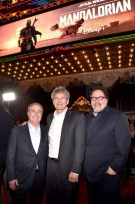 "HOLLYWOOD, CALIFORNIA - NOVEMBER 13: (L-R) Co-Chairman, The Walt Disney Studios Alan Bergman, Co-Chairman and Chief Creative Officer of The Walt Disney Studios Alan Horn and Executive Producer Jon Favreau arrive at the premiere of Lucasfilm's first-ever, live-action series, ""The Mandalorian,"" at the El Capitan Theatre in Hollywood, Calif. on November 13, 2019. ""The Mandalorian"" streams exclusively on Disney+. (Photo by Alberto E. Rodriguez/Getty Images for Disney)"