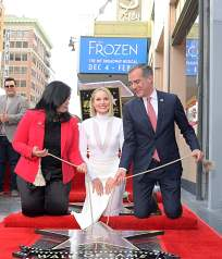 LOS ANGELES, CALIFORNIA - NOVEMBER 19: Hollywood Chamber of Commerce, President/CEO Rana Ghadban, Kristen Bell and Mayor of Los Angeles Eric Garcetti attend the double Walk of Fame ceremony in Hollywood, Calif., where Kristen Bell and Idina Menzel from Disney's FROZEN 2 were each presented with a star on the Hollywood Walk of Fame on November 19, 2020. (Photo by Charley Gallay/Getty Images for Disney )