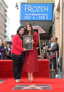 LOS ANGELES, CALIFORNIA - NOVEMBER 19: Hollywood Chamber of Commerce, President/CEO Rana Ghadban and Idina Menzel attend the double Walk of Fame ceremony in Hollywood, Calif., where Kristen Bell and Idina Menzel from Disney's FROZEN 2 were each presented with a star on the Hollywood Walk of Fame on November 19, 2020. (Photo by Charley Gallay/Getty Images for Disney )