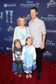 """HOLLYWOOD, CALIFORNIA - NOVEMBER 07: (L-R) Hutton Michael Cameron, Beverley Mitchell, Kenzie Cameron, and Michael Cameron attend the world premiere of Disney's """"Frozen 2"""" at Hollywood's Dolby Theatre on Thursday, November 7, 2019 in Hollywood, California. (Photo by Jesse Grant/Getty Images for Disney)"""