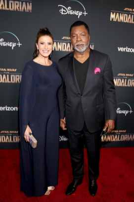 "HOLLYWOOD, CALIFORNIA - NOVEMBER 13: (L-R) Christine Klvdjian and Carl Weathers arrive at the premiere of Lucasfilm's first-ever, live-action series, ""The Mandalorian,"" at the El Capitan Theatre in Hollywood, Calif. on November 13, 2019. ""The Mandalorian"" streams exclusively on Disney+. (Photo by Jesse Grant/Getty Images for Disney)"