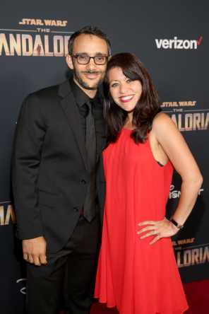 "HOLLYWOOD, CALIFORNIA - NOVEMBER 13: (L-R) Omid Abtahi and Sabina Bolin arrive at the premiere of Lucasfilm's first-ever, live-action series, ""The Mandalorian,"" at the El Capitan Theatre in Hollywood, Calif. on November 13, 2019. ""The Mandalorian"" streams exclusively on Disney+. (Photo by Jesse Grant/Getty Images for Disney)"