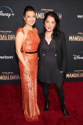 "HOLLYWOOD, CALIFORNIA - NOVEMBER 13: (L-R) Ming-Na Wen and Director Deborah Chow arrive at the premiere of Lucasfilm's first-ever, live-action series, ""The Mandalorian,"" at the El Capitan Theatre in Hollywood, Calif. on November 13, 2019. ""The Mandalorian"" streams exclusively on Disney+. (Photo by Jesse Grant/Getty Images for Disney)"