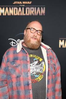 "HOLLYWOOD, CALIFORNIA - NOVEMBER 13: Brian Posehn arrives at the premiere of Lucasfilm's first-ever, live-action series, ""The Mandalorian,"" at the El Capitan Theatre in Hollywood, Calif. on November 13, 2019. ""The Mandalorian"" streams exclusively on Disney+. (Photo by Jesse Grant/Getty Images for Disney)"