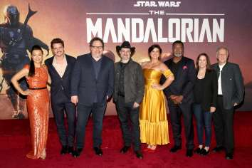 "HOLLYWOOD, CALIFORNIA - NOVEMBER 13: (L-R) Ming-Na Wen, Pedro Pascal, Showrunner/executive producer Jon Favreau, Executive producer/director Dave Filoni, Gina Carano, Carl Weathers, Executive producer Kathleen Kennedy and Werner Herzog arrive at the premiere of Lucasfilm's first-ever, live-action series, ""The Mandalorian,"" at the El Capitan Theatre in Hollywood, Calif. on November 13, 2019. ""The Mandalorian"" streams exclusively on Disney+. (Photo by Jesse Grant/Getty Images for Disney)"