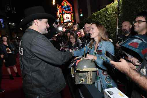 "Director Dave Filoni signs autographs for fans at the premiere of Lucasfilm's first-ever, live-action series, ""The Mandalorian"", at the El Capitan Theatre in Hollywood, CA on November 13, 2019. ""The Mandalorian"" streams exclusively on Disney+.(photo: Alex J. Berliner/ABImages)"