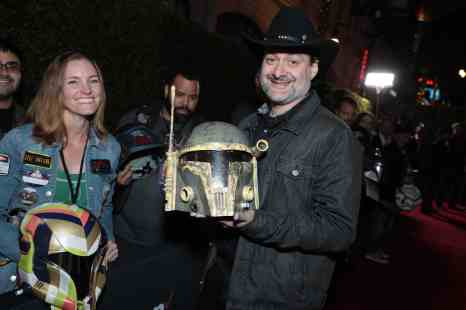 "Director Dave Filoni poses with fan art at the premiere of Lucasfilm's first-ever, live-action series, ""The Mandalorian"", at the El Capitan Theatre in Hollywood, CA on November 13, 2019. ""The Mandalorian"" streams exclusively on Disney+.(photo: Alex J. Berliner/ABImages)"
