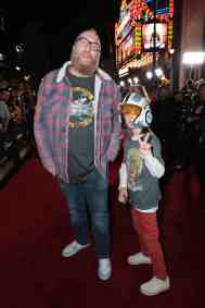 "Brian Posehn and son arrive at the premiere of Lucasfilm's first-ever, live-action series, ""The Mandalorian"", at the El Capitan Theatre in Hollywood, CA on November 13, 2019. ""The Mandalorian"" streams exclusively on Disney+.(photo: Alex J. Berliner/ABImages)"