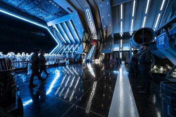 First Order troops and stormtroopers patrol the hangar bay of a Star Destroyer in Star Wars: Rise of the Resistance, the groundbreaking new attraction opening Dec. 5, 2019, inside Star Wars: Galaxy's Edge at Disney's Hollywood Studios in Florida and Jan. 17, 2020, at Disneyland Park in California. Guests enter the hangar bay after their ship is caught in the Star Destroyer's tractor beam in this thrilling new Disney experience. (Matt Stroshane, photographer)